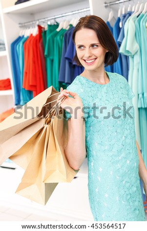 Carefree girl shopping in store - stock photo