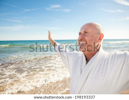carefree man with outstretched arms happy beach - stock photo
