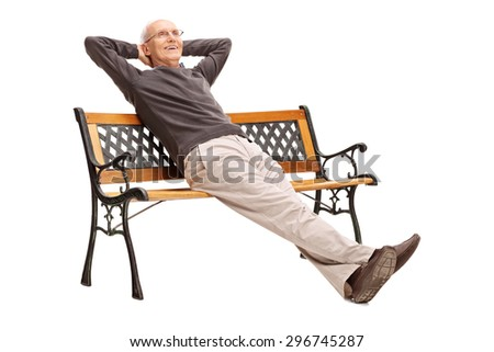 Carefree senior sitting comfortably on a wooden bench and looking in the distance isolated on white background - stock photo
