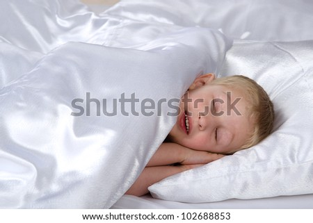 Carefree sleeping little boy - stock photo