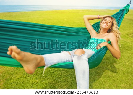 carefree woman relaxing in a hammock - stock photo