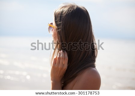 Carefree young woman feeling alive and free in nature breathing clean and fresh air. Summer vacation concept - stock photo