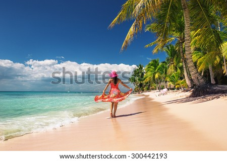 Carefree, Young woman relaxing on the islands beach - stock photo