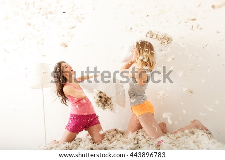 Carefree young women making pajama party - stock photo