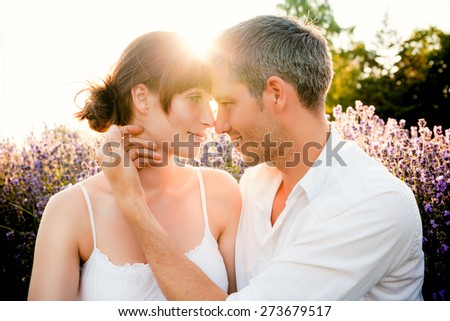 carefully touching face of girlfriend - stock photo