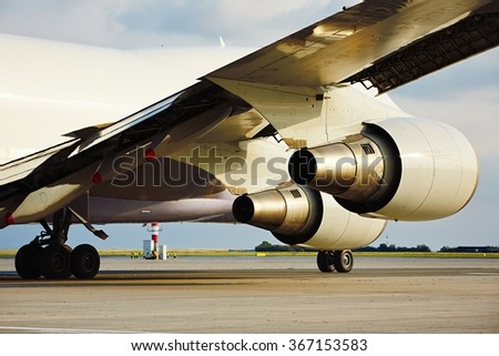 Cargo airplane is taxiing to take off - stock photo