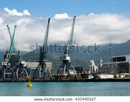 Cargo and transportation industry - cargo shipping and commercial terminal in seaport Batumi, Georgia. Industrial landscape with gantry cranes in a sea port. - stock photo