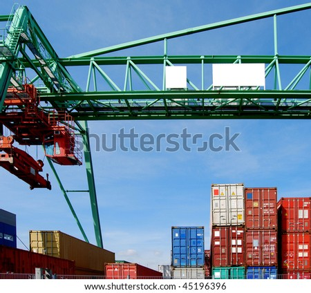 Cargo container and a huge crane in a harbour - stock photo