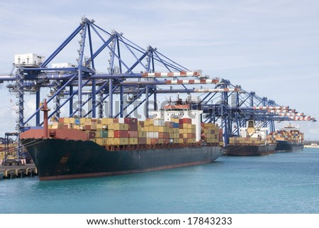 Cargo container ship in port - stock photo