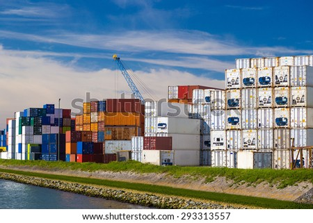 Cargo containers stacked in Port of Rotterdam - stock photo