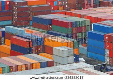 Cargo containers stacks at container terminal - stock photo