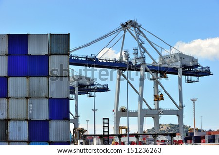 Cargo cranes are working at the port of Auckland, New Zealand. - stock photo
