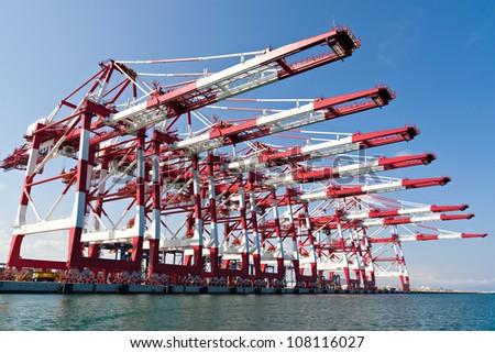 Cargo Cranes in Industrial Port - stock photo