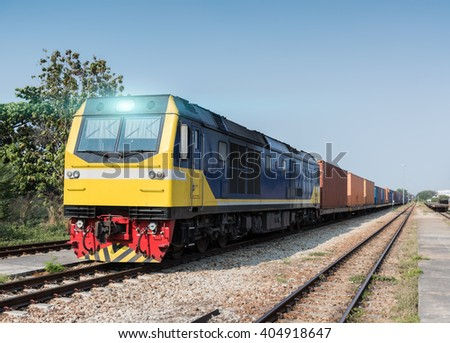 Cargo freight diesel train with container - stock photo