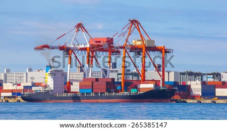 Cargo freight ship with stacked container at harbor terminal..   - stock photo
