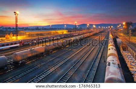 Cargo freigt train railroad station at dusk - stock photo