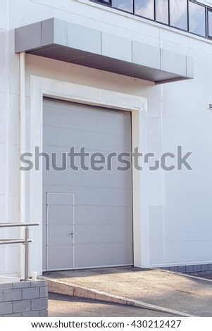 cargo gate in an industrial building - stock photo