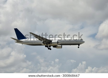 Cargo jet airplane in flight side view - stock photo