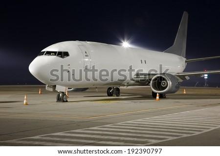 Cargo plane at night - stock photo