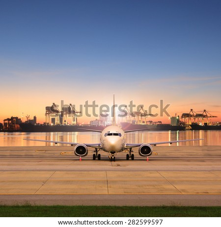 cargo plane parking in airport runways and shipping port behind use for ship port logistic and air freight delivery service - stock photo