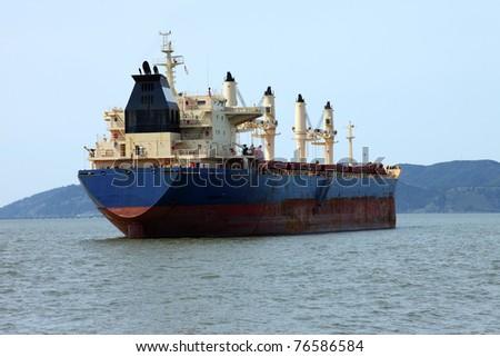 Cargo ship anchored in Astoria OR. - stock photo