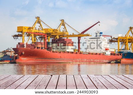Cargo ship and container with blue sky background. - stock photo