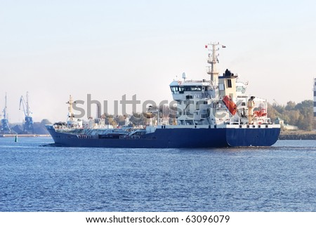 cargo ship arriving in the port - stock photo