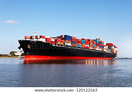 Cargo ship at the port - stock photo