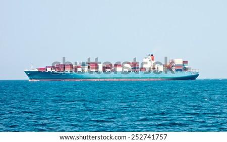 cargo ship in the sea - stock photo