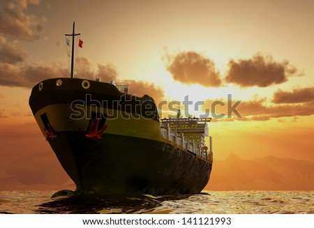 Cargo ship in the sea at sunset. - stock photo