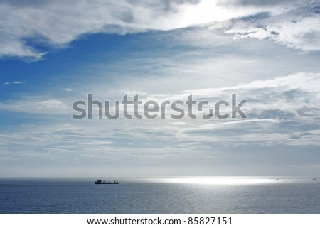 cargo ship in widely sea - stock photo