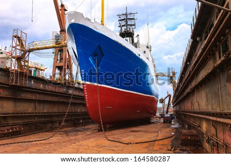 Cargo ship is being renovated in shipyard Gdansk, Poland. - stock photo