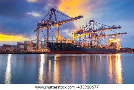 Cargo ship loading containers at sunshine - stock photo