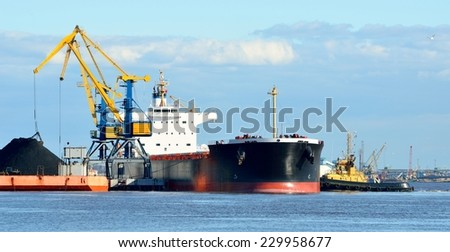 cargo ship loading in coal cargo terminal - stock photo