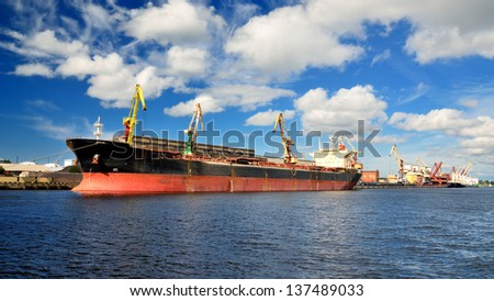 cargo ship loading in port. Ventspils terminal - stock photo