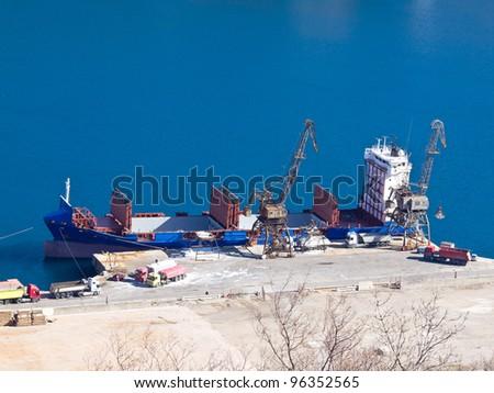 cargo ship loading on the dock - stock photo