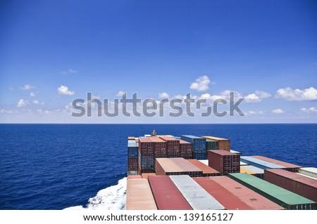 cargo ship move to the ocean - stock photo