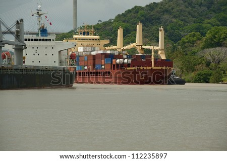 Cargo ship on waters nearby Pedro Miguel locks. Panama Canal,Panama, Central America. - stock photo