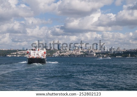 cargo ship sailing in to the sea - stock photo