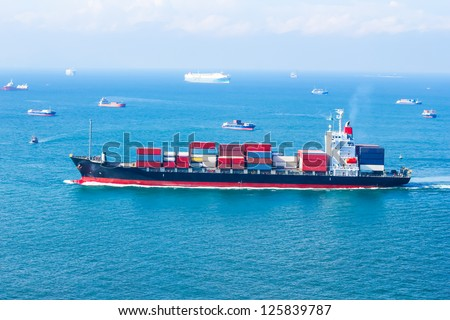 cargo ship sailing on the sea - stock photo