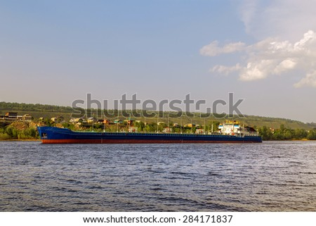 cargo ship tanker sailing along the coast. - stock photo