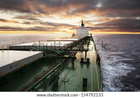 Cargo ship underway viewed from bow - stock photo