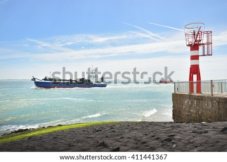 Cargo ships are sailing near Vlissingen, the Netherlands - stock photo