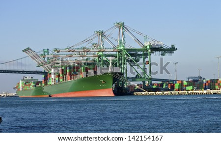 Cargo ships loading and unloading cargo in Long Beach industrial seaport. - stock photo