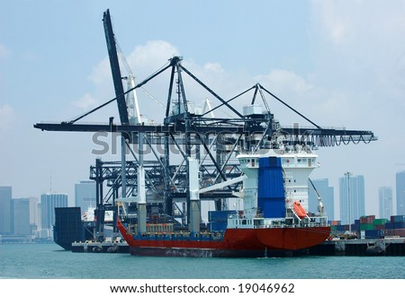 Cargo ships loading containers at the Port of Miami, FLorida - stock photo