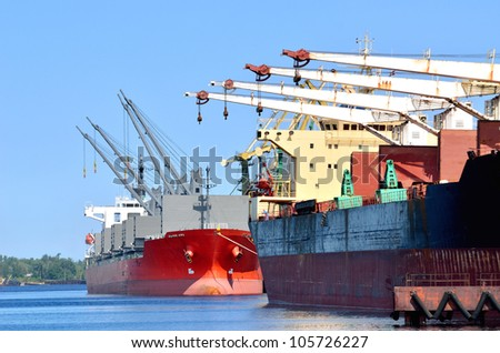 cargo ships loading in cargo terminal - stock photo