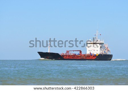 Cargo tanker ship sailing next to the coast of Vlissingen, the Netherlands - stock photo