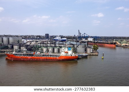 Cargo tanker vessel in sea port Rotterdam, Netherlands. - stock photo