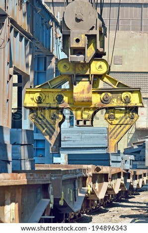 Cargo train platform with steel plate in plant - stock photo