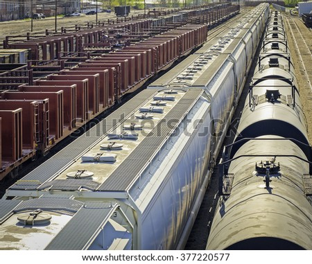 Cargo trains in a large train yard. - stock photo